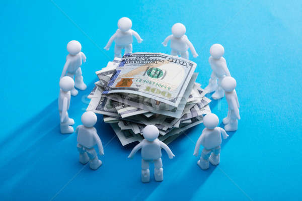Stacked Banknotes Surrounded By Human Figures Stock photo © AndreyPopov