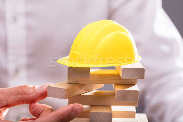 Yellow Hardhat Over Stacked Wooden Blocks Stock photo © AndreyPopov