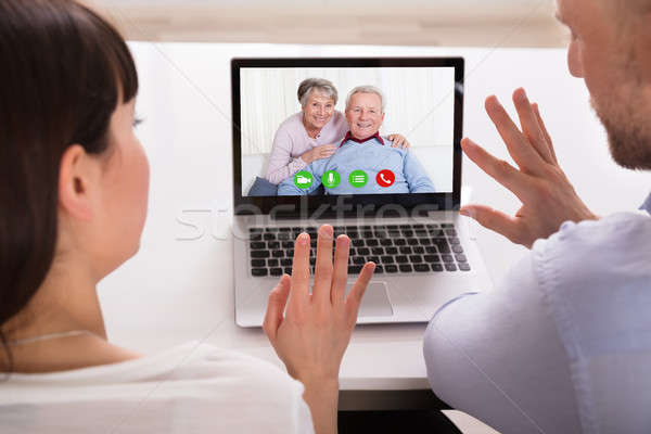 Couple Video Conferencing On Laptop Stock photo © AndreyPopov