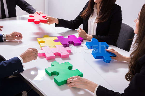 Group Of Businesspeople Solving Jigsaw Puzzle Stock photo © AndreyPopov