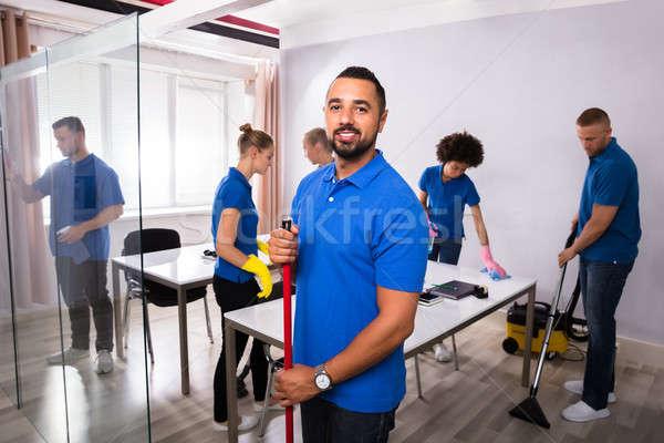 Portré férfi gondnok boldog iroda nő Stock fotó © AndreyPopov