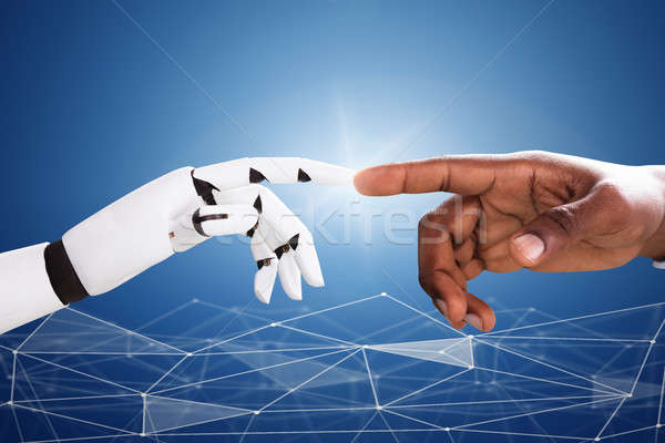 Robot Touching Man's Index Finger Stock photo © AndreyPopov