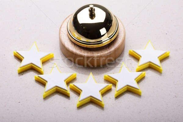 Elevated View Of Service Bell And Five Star Rating Icon Stock photo © AndreyPopov
