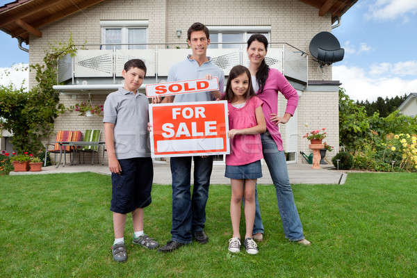 Young family happy to have bought a home Stock photo © AndreyPopov