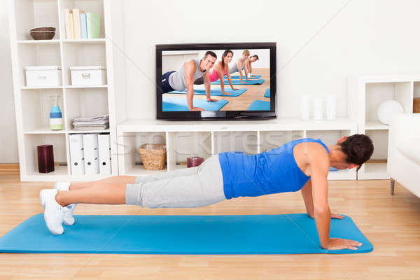 Woman Exercising At Home Stock photo © AndreyPopov