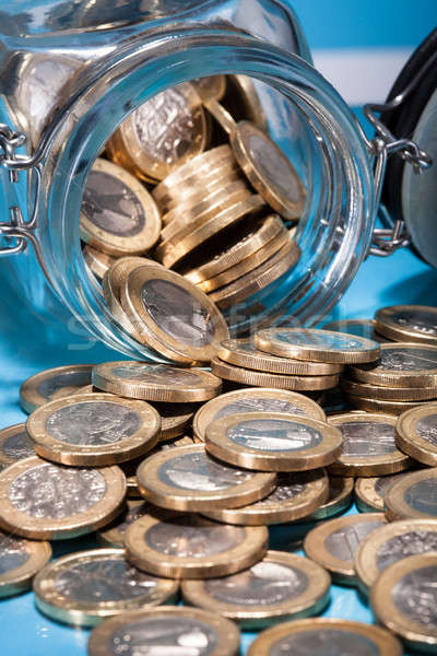 Euro Coins Spilling From Jar Stock photo © AndreyPopov