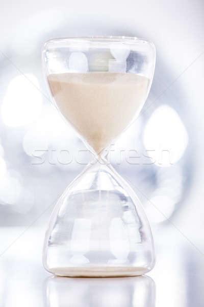 Sand Flowing Through An Hourglass Stock photo © AndreyPopov
