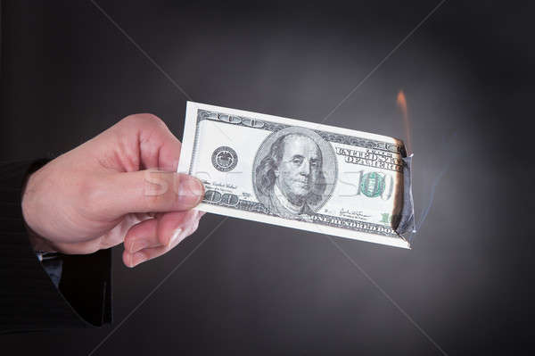 Close-up Of Hand Holding Burning Banknote Stock photo © AndreyPopov