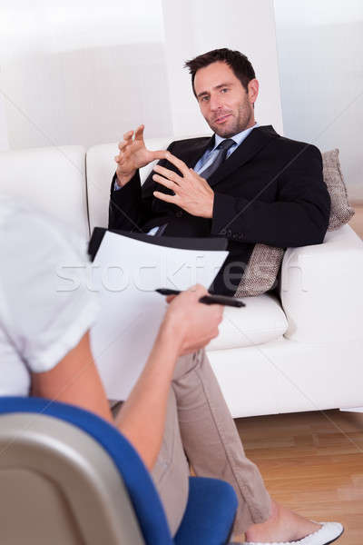 Man talking to his psychiatrist Stock photo © AndreyPopov
