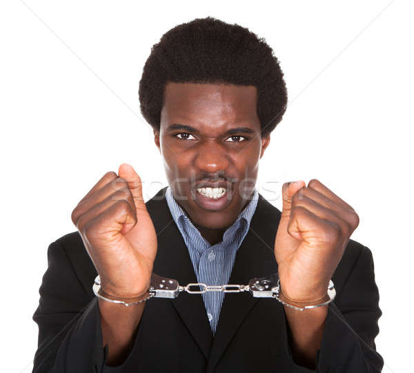 Arrestato uomo mani giovani african Foto d'archivio © AndreyPopov