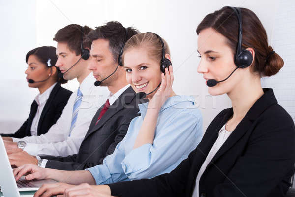 Business People Wearing Headset Working In Office Stock photo © AndreyPopov