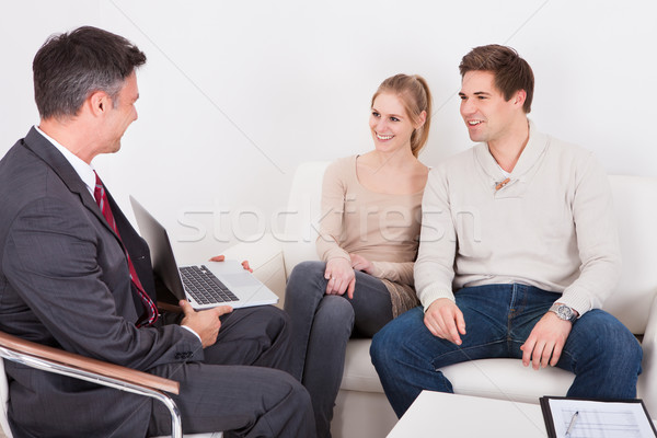 Consultant Advising Young Couple Stock photo © AndreyPopov