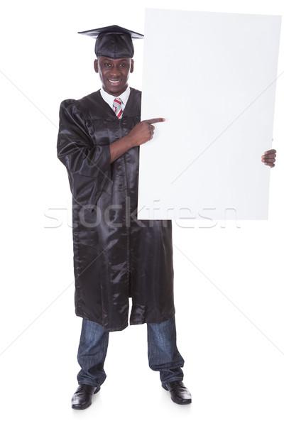 érettségi férfi számla tábla fiatal tart Stock fotó © AndreyPopov