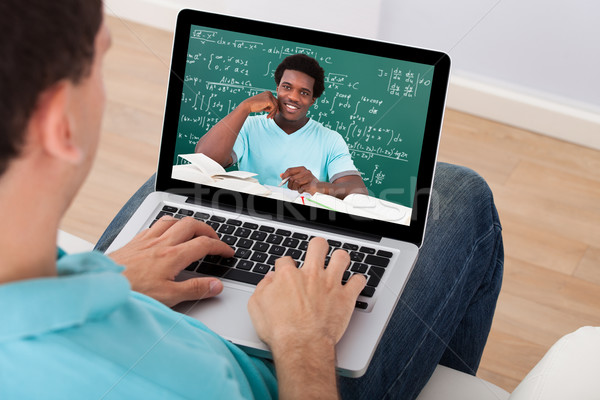 Man Attending Online Math's Lecture At Home Stock photo © AndreyPopov
