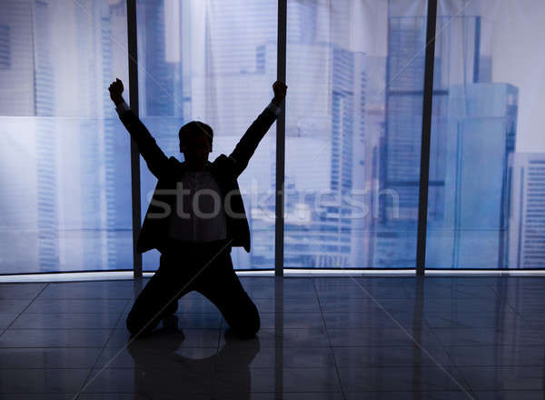 Businessman Sitting Arms Outstretched By Office Window Stock photo © AndreyPopov