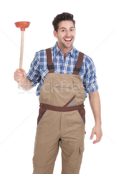 Excited Young Male Plumber Holding Plunger Stock photo © AndreyPopov