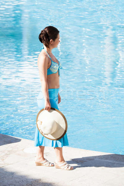 Young woman walking at poolside Stock photo © AndreyPopov