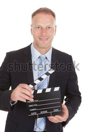 Businessman Holding Clapperboard Stock photo © AndreyPopov
