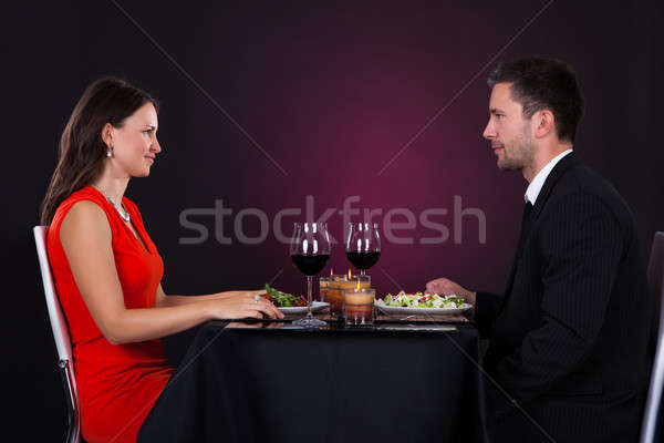 Stock photo: Couple Tossing Wine Glass