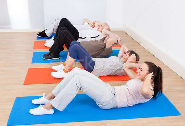 People Doing Sit Ups At Gym Stock photo © AndreyPopov