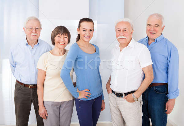 Confident Caregiver With Senior People Stock photo © AndreyPopov