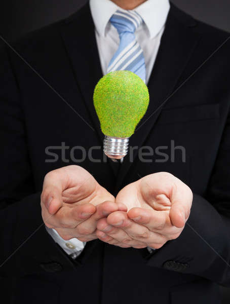 Businessman With Green Bulb Stock photo © AndreyPopov