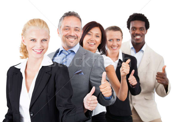 Business People Gesturing Thumbsup Over White Background Stock photo © AndreyPopov