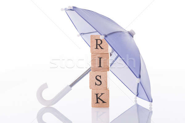 Riesgo paraguas aislado blanco madera Foto stock © AndreyPopov