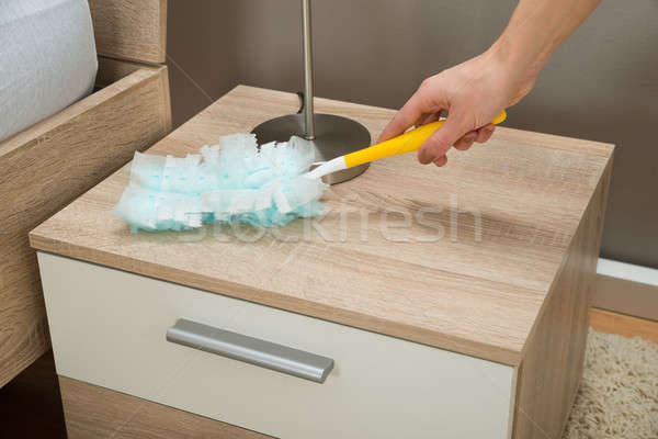 Close-up Of Hand Removing Dust With Duster Feather Stock photo © AndreyPopov