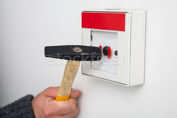 Person Breaking Glass Of Emergency Button Stock photo © AndreyPopov
