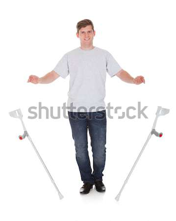 Happy Man In Casuals Standing Against White Background Stock photo © AndreyPopov