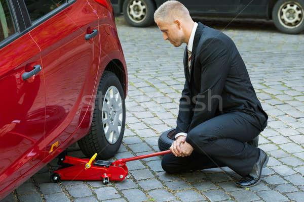 человека красный гидравлический полу автомобилей Сток-фото © AndreyPopov