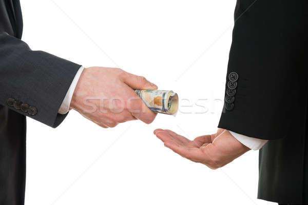 Businessman Taking Bribe Stock photo © AndreyPopov