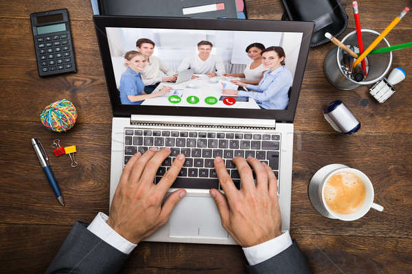 Businessman In Video Conference Stock photo © AndreyPopov