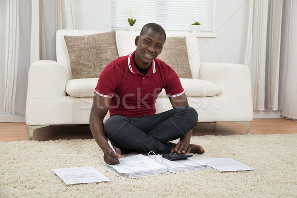 Man Calculating Invoices Stock photo © AndreyPopov