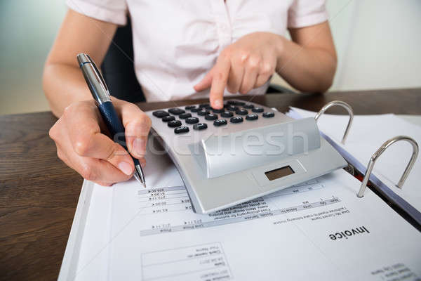 Accountant Calculating Receipt Stock photo © AndreyPopov