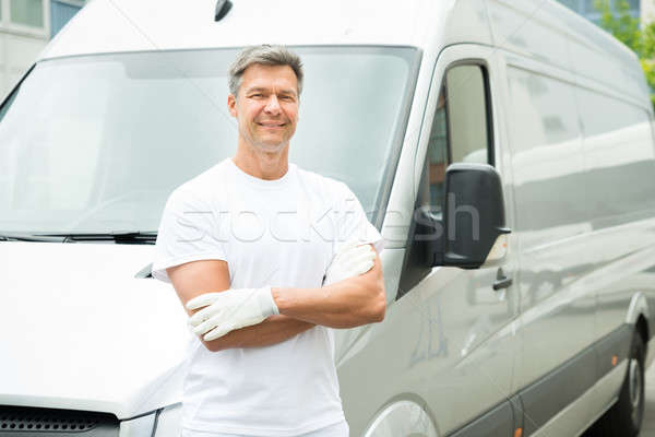Painter With Arms Crossed In Front Of Van Stock photo © AndreyPopov