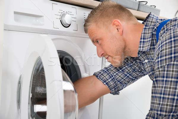 Ezermester javít mosógép közelkép profi átfogó Stock fotó © AndreyPopov