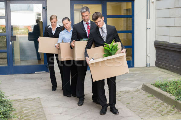 Disappointed Businesspeople With Cardboard Boxes Stock photo © AndreyPopov