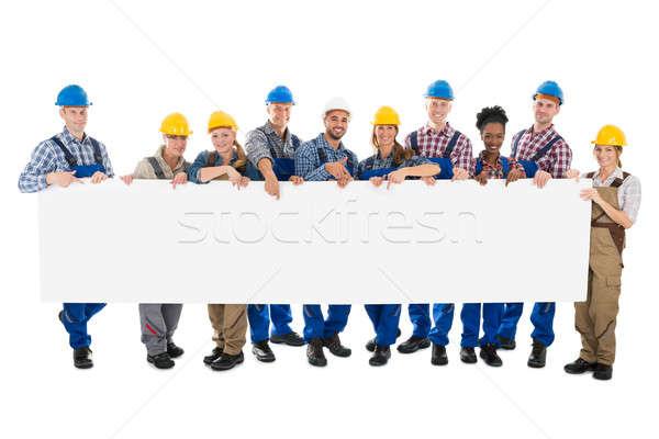 Felice costruzione lavoratori cartellone ritratto Foto d'archivio © AndreyPopov