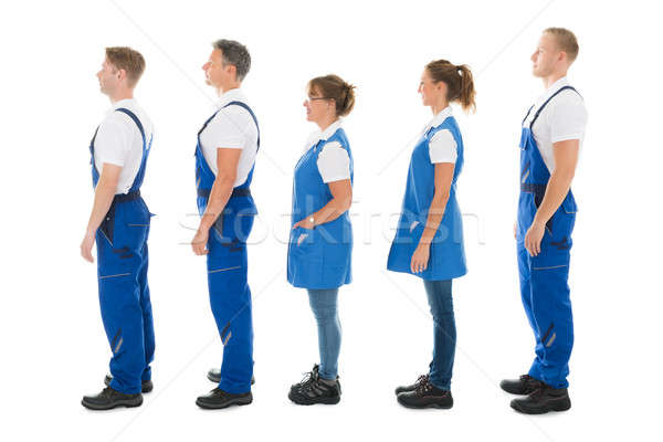 Side View Of Janitors Standing In Queue Stock photo © AndreyPopov