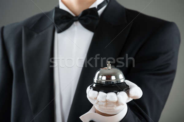 Midsection Of Waiter Holding Service Bell Stock photo © AndreyPopov