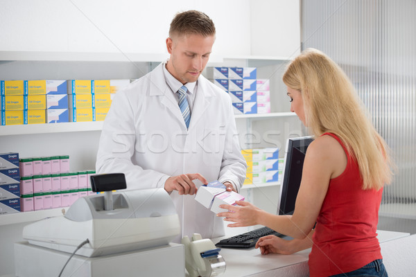 Pharmacist Explaining Medicines To Customer Stock photo © AndreyPopov