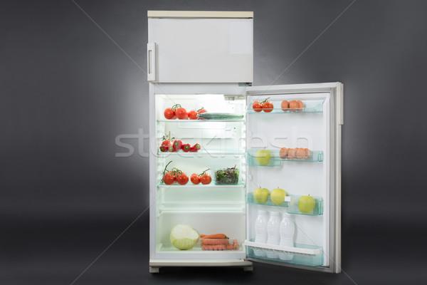 Abierto refrigerador completo alimentos alimentos frescos aislado Foto stock © AndreyPopov