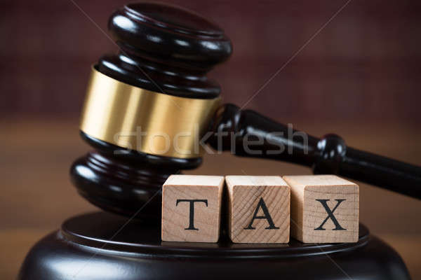 Tax Wooden Blocks On Mallet In Courtroom Stock photo © AndreyPopov