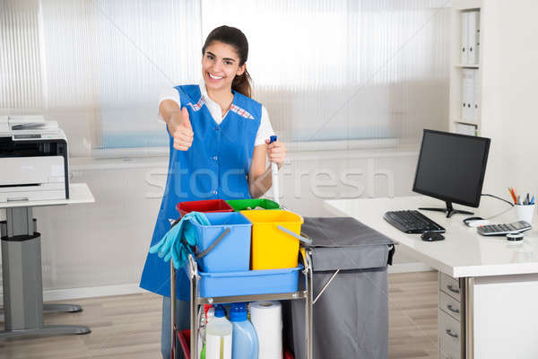 Janitor With Cleaning Equipment Showing Thumbs Up In Office Stock photo © AndreyPopov