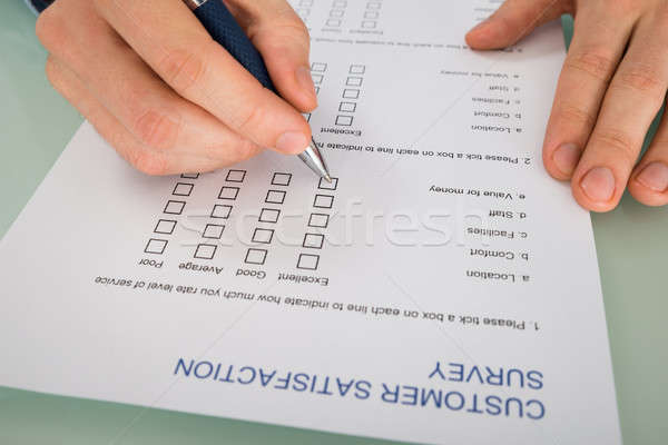 Person Hand Filling Customer Satisfaction Form Stock photo © AndreyPopov
