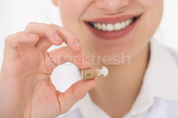 Stockfoto: Gelukkig · vrouwelijke · arts · gehoorapparaat