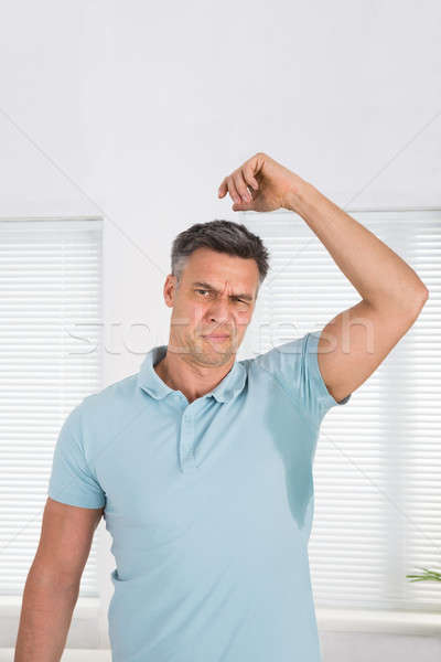 Man Sweating Very Badly Under Armpit Stock photo © AndreyPopov