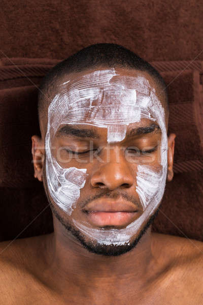Face Mask Applied To Young Man Stock photo © AndreyPopov